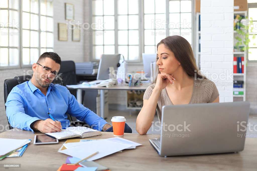Two colleagues at workplace stock photo