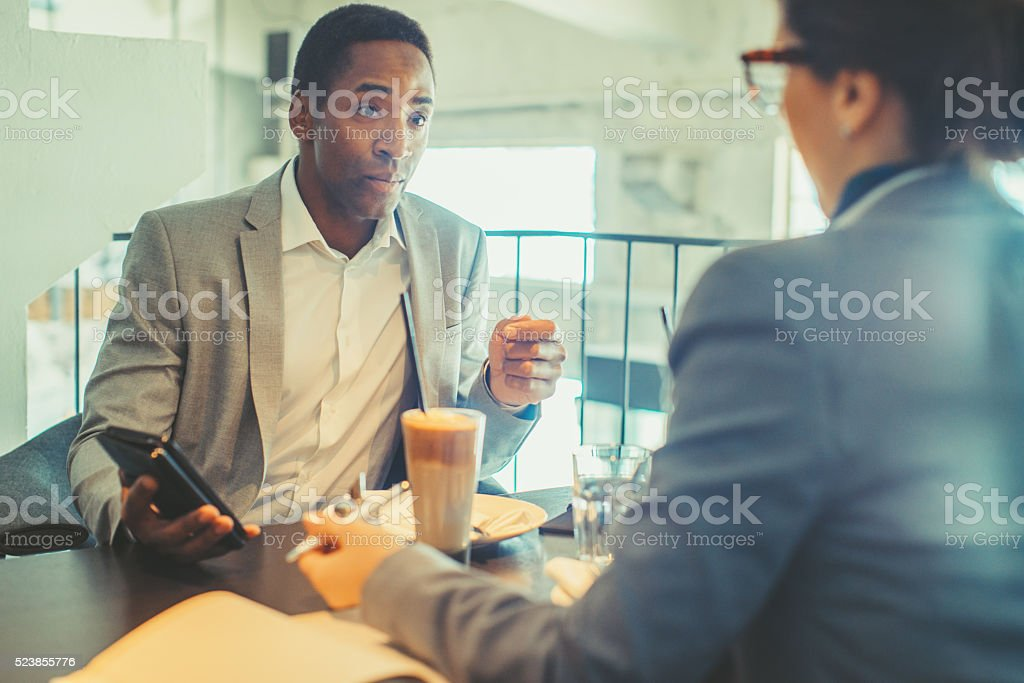 two collegaues having business lunch stock photo