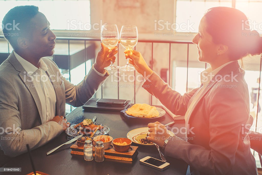 two collegaues toasting stock photo