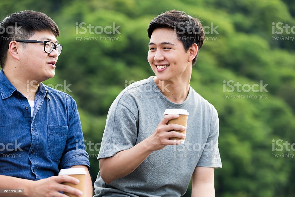 Two College Friends Having a Coffee Break stock photo