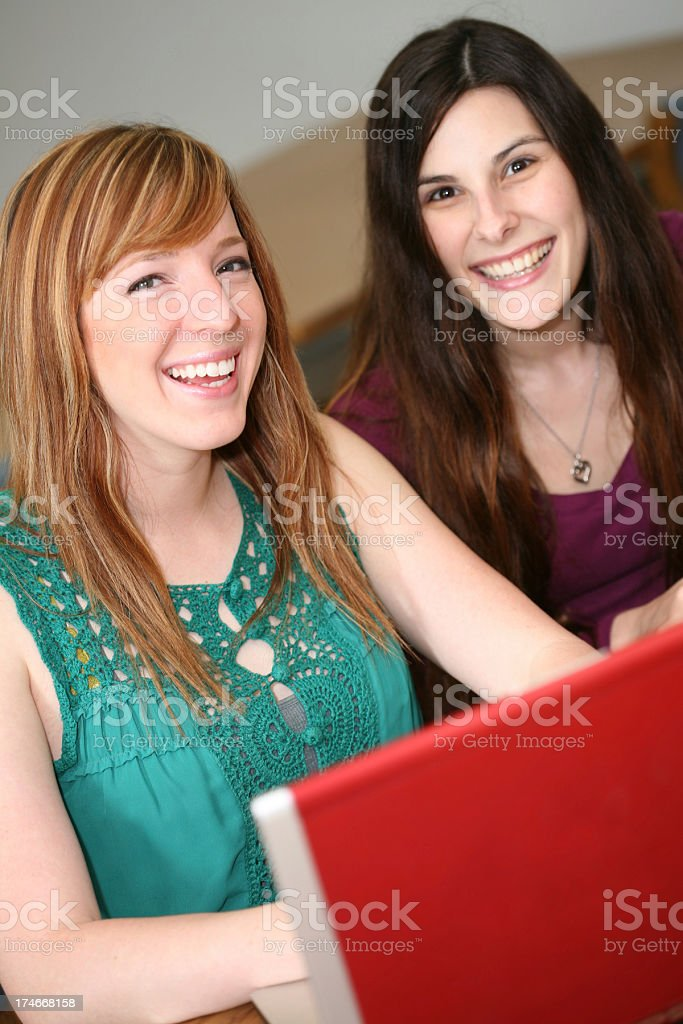 Two College Students Working on the computer in Library royalty-free stock photo