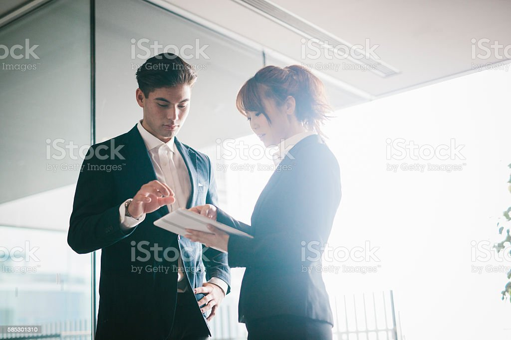 Two Collegues Meet in the Office stock photo