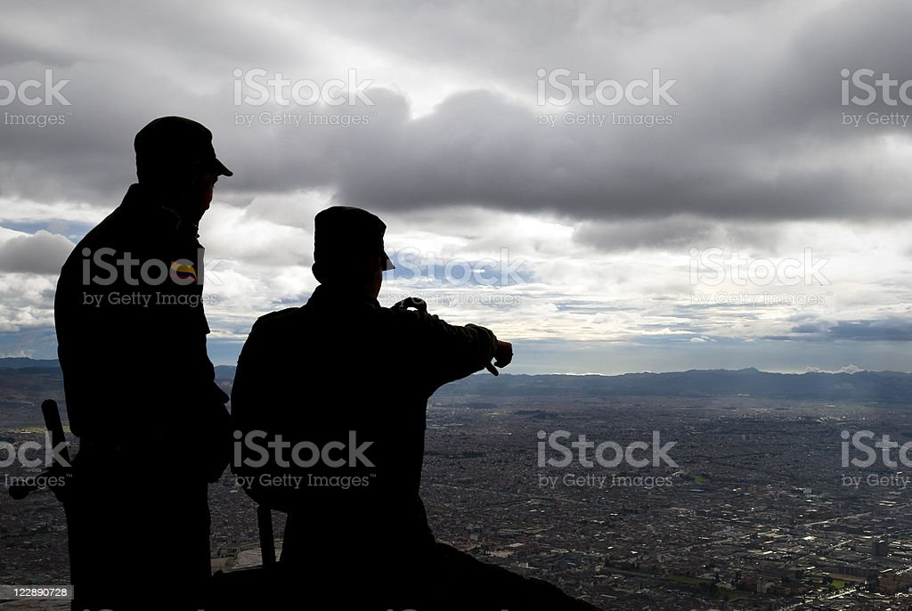 Security personnel looking down on Bogota, Colombia royalty-free stock photo