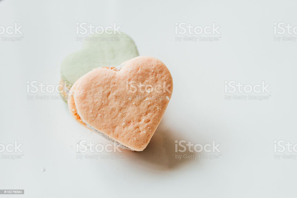 Two color alfajores cornstarch with heart shape on white backgro stock photo