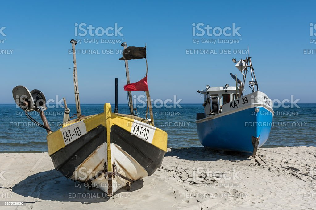 Two colorful fishing boats on the sand. stock photo