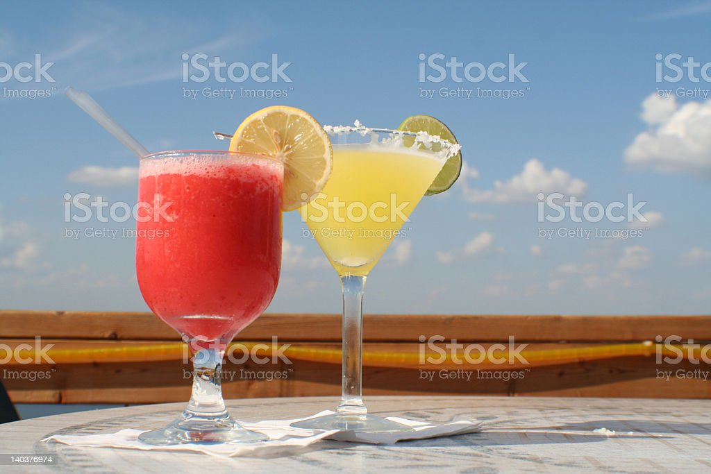 Two Colorful Frozen Drinks on a Deck stock photo