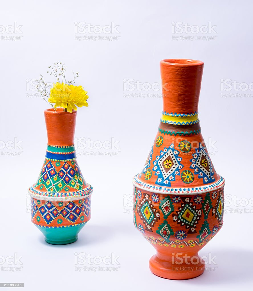 Two colorful pottery vases with yellow flower on white background stock photo