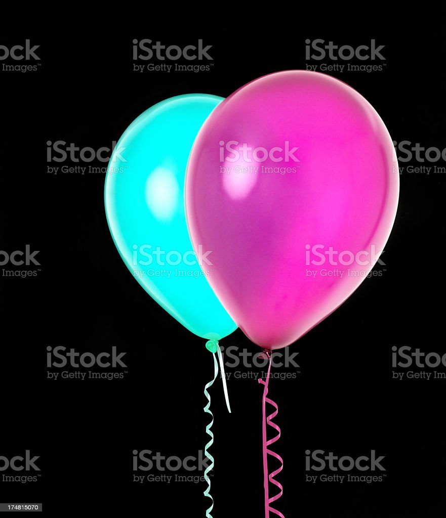 Two coloured balloons on black royalty-free stock photo