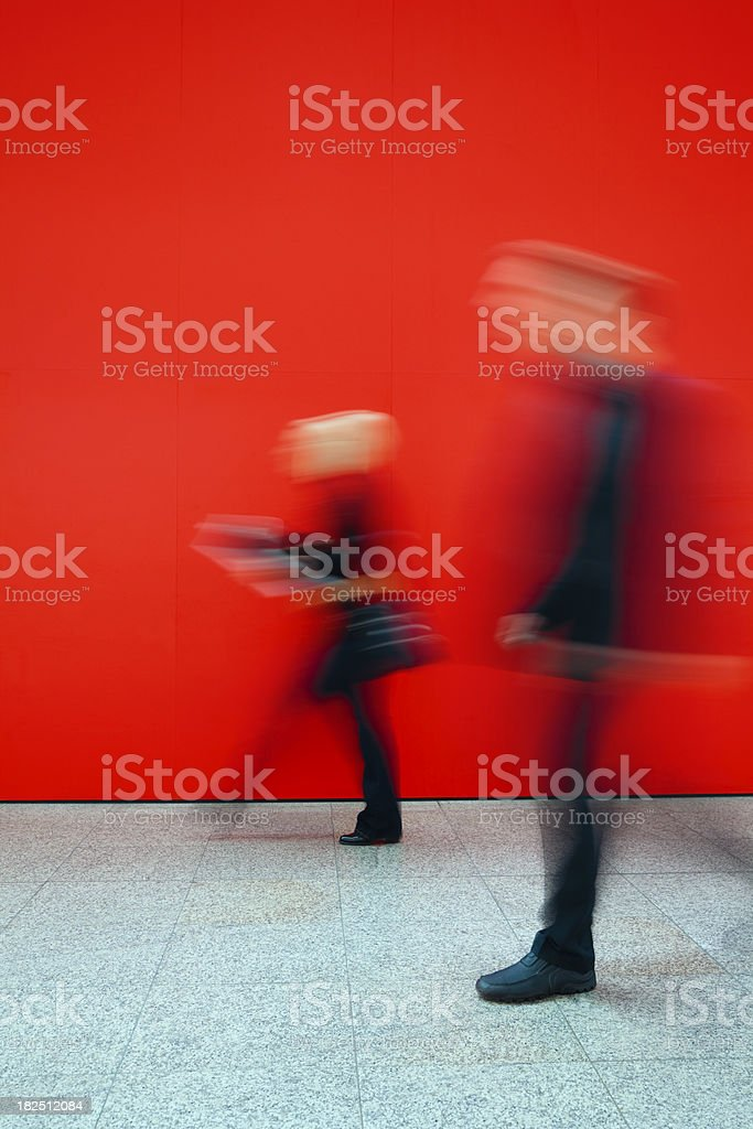 Two Commuters Walking Through Office Hallway, Blurred Motion royalty-free stock photo