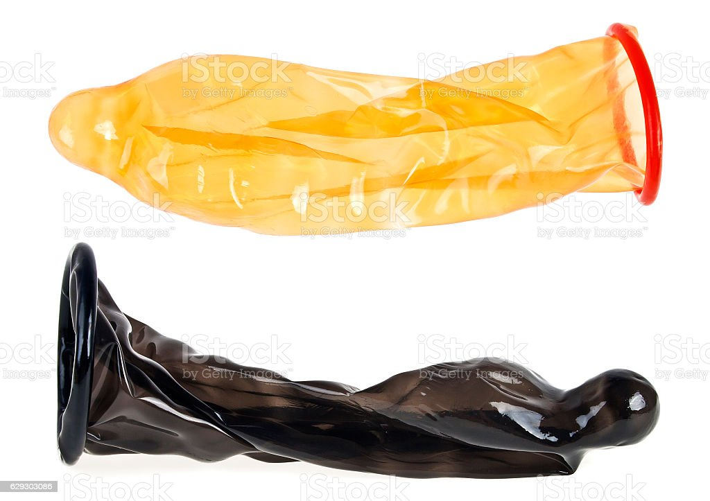 Two condoms on white background, ready to use stock photo