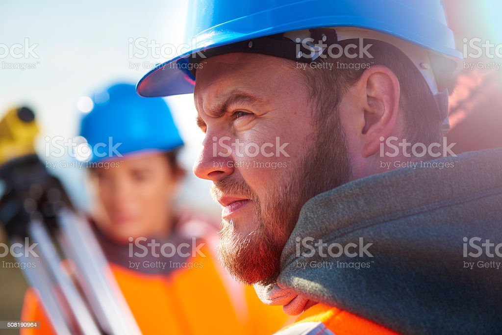 two construction site surveyors stock photo