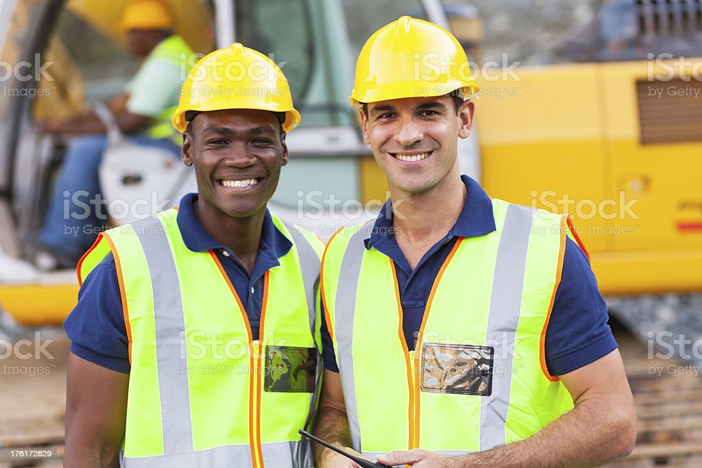 Two construction workers at work royalty-free stock photo