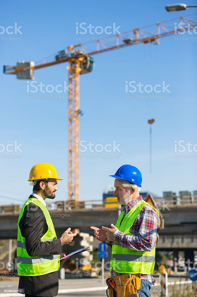 Two Construction Workers Discussing royalty-free stock photo