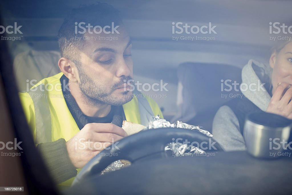 Two construction workers having lunch break royalty-free stock photo