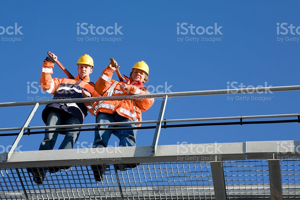Two construction workers on a bridge royalty-free stock photo