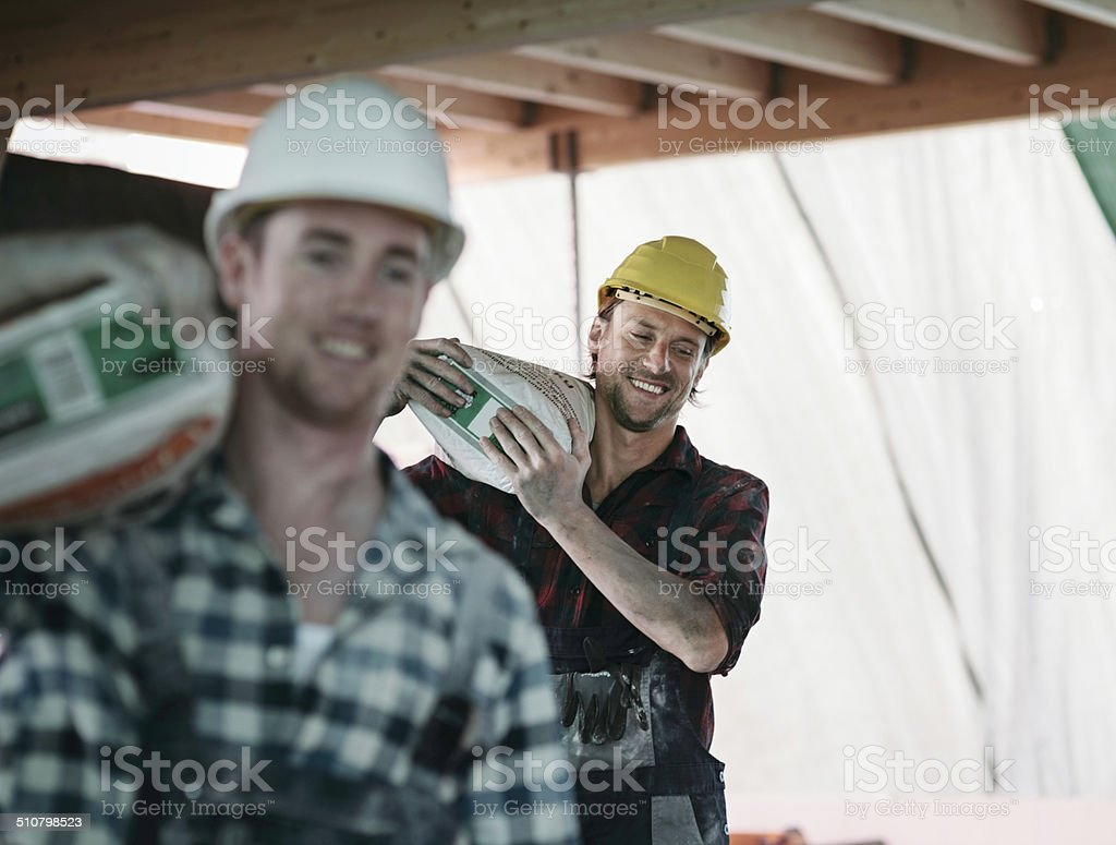 Two Construction workers on Building site stock photo