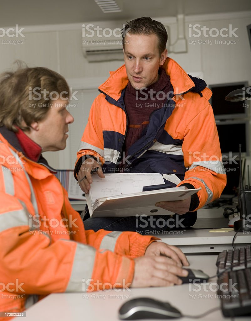 Two constructionworkers in control room royalty-free stock photo