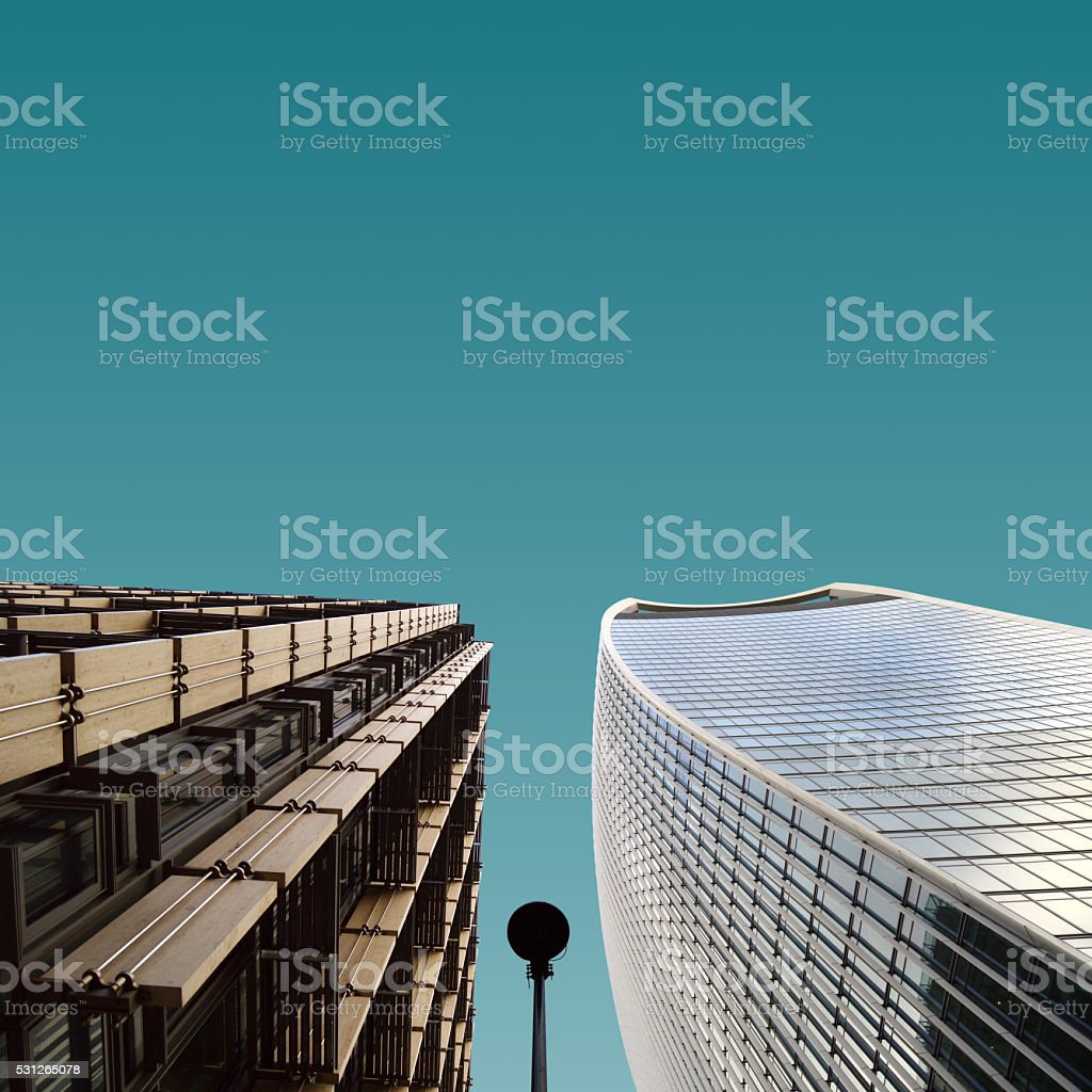 Two contrast colour adjacent building stock photo