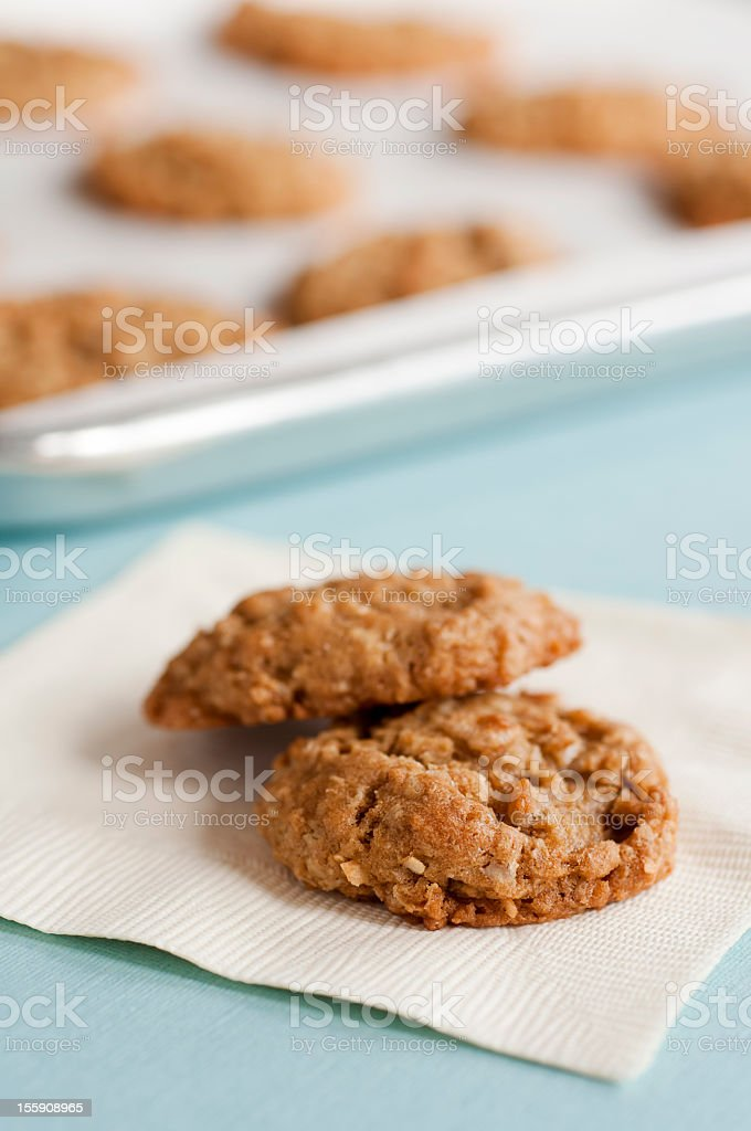 Two Cookies on a Napkin with Cookie Tray in Background stock photo