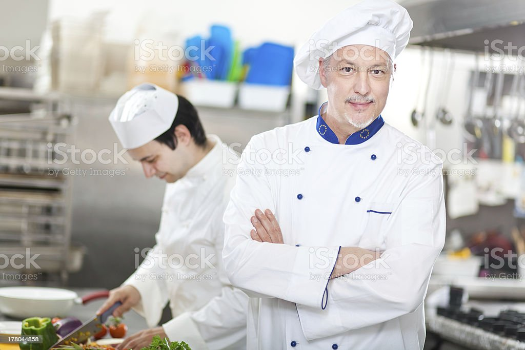 Two cooks in a kitchen stock photo
