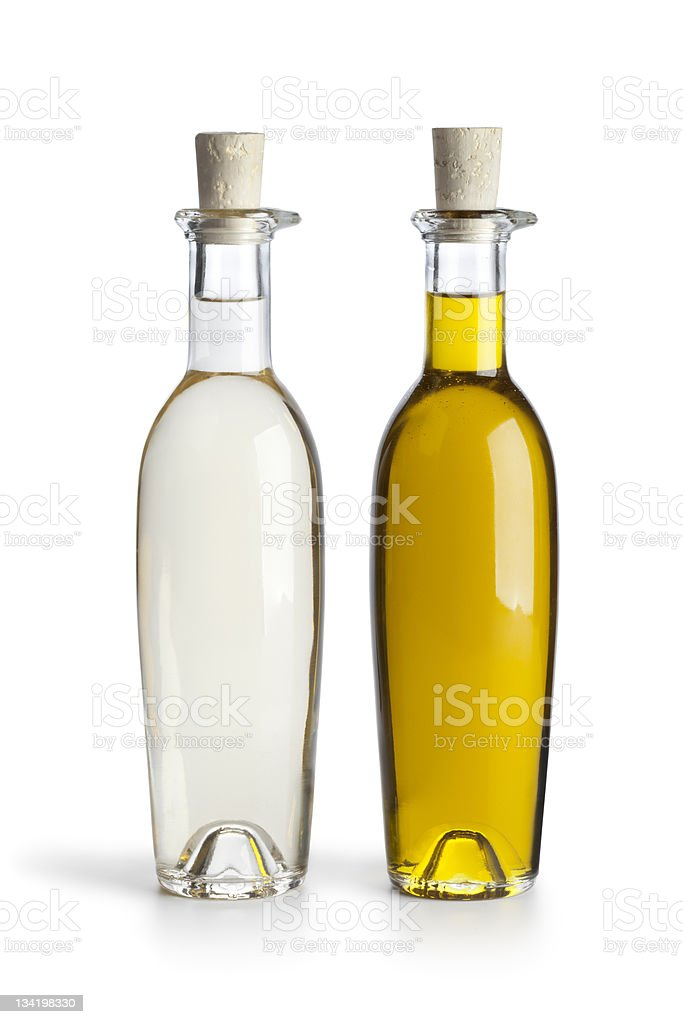 Two corked bottles of oil and vinegar on white background stock photo