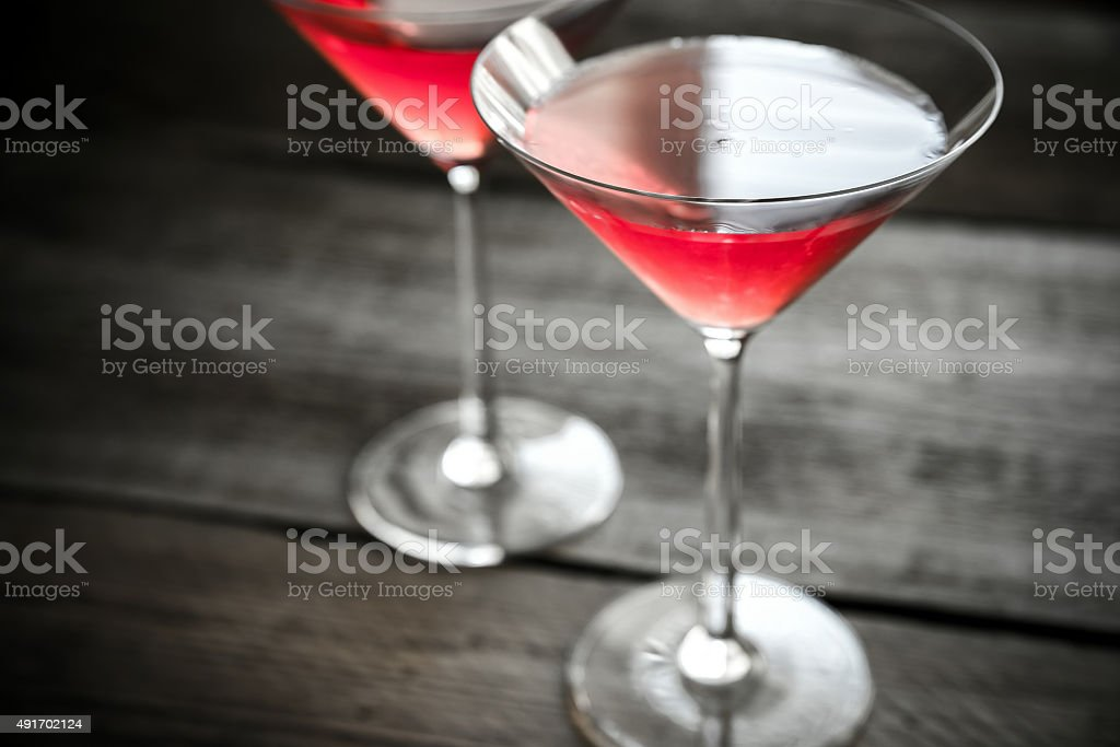 Two cosmopolitan cocktails on the wooden background stock photo