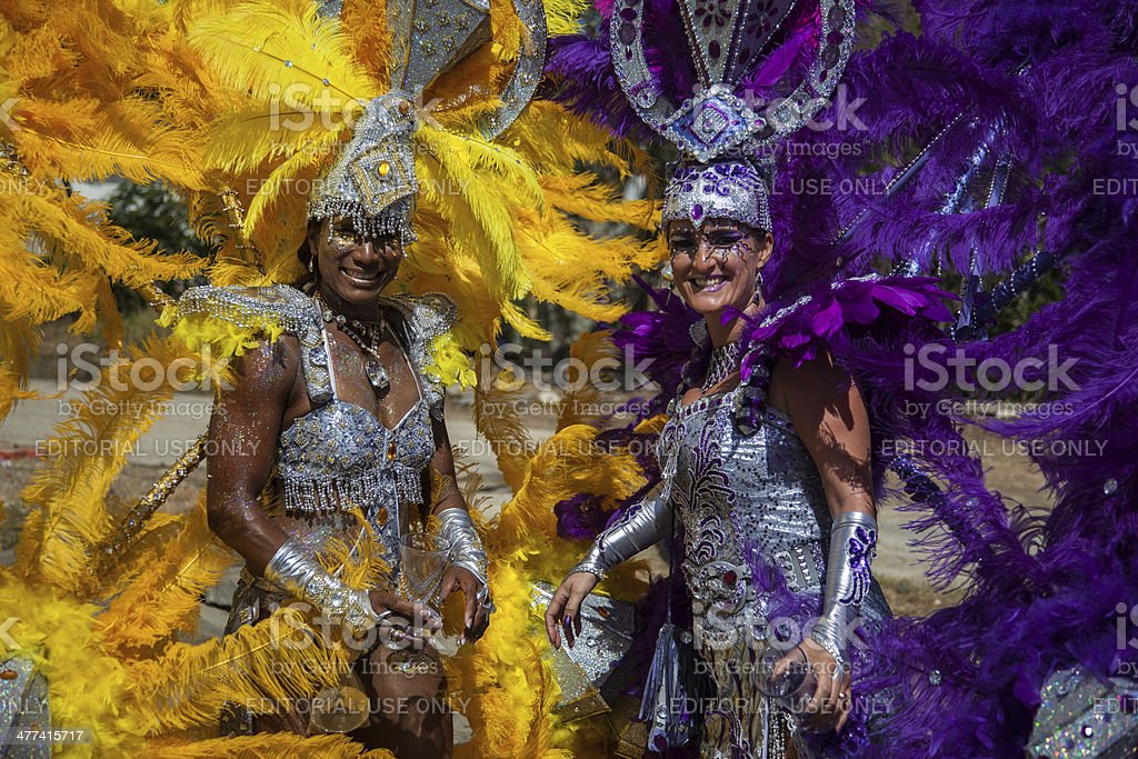 Two Costumed Women Participates In Carnival Parade in Bonaire stock photo