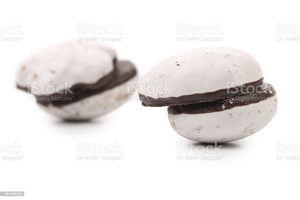 Two couple of chocolate meringues. stock photo