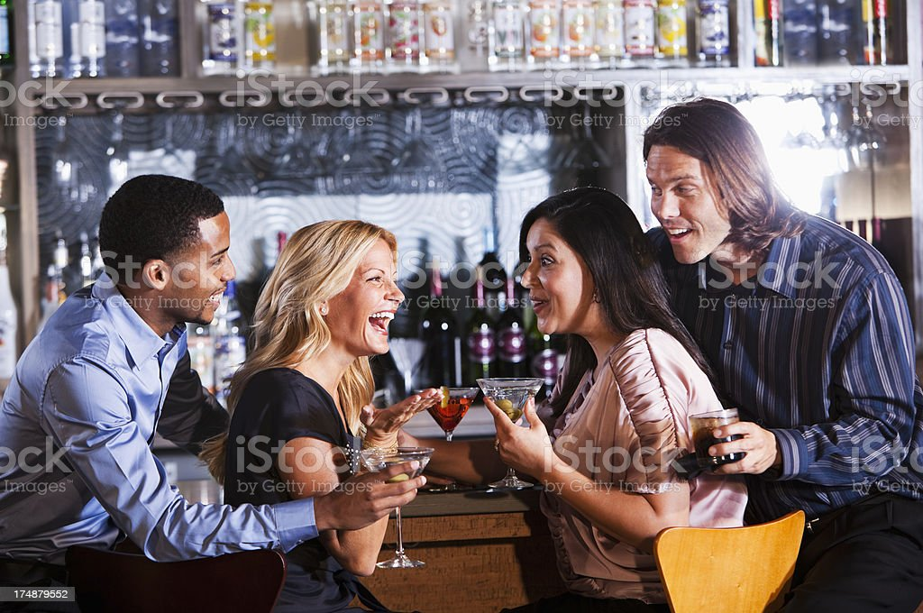 Two couples at bar royalty-free stock photo
