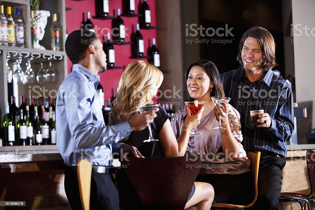 Two couples at bar stock photo
