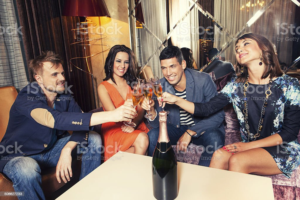 Two couples at club celebrating stock photo