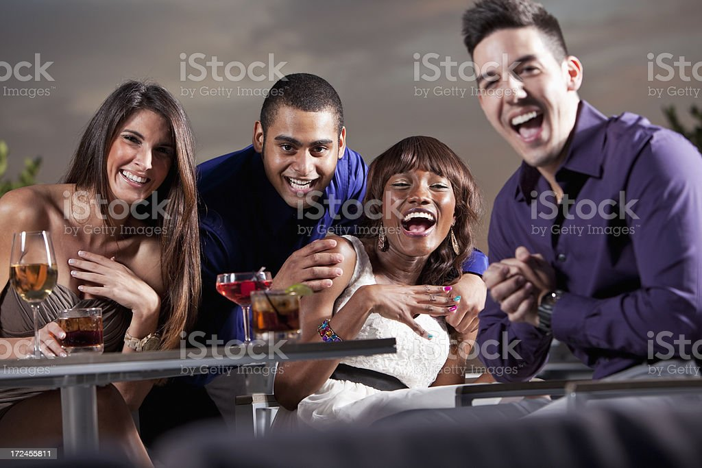 Two couples drinking and having fun stock photo