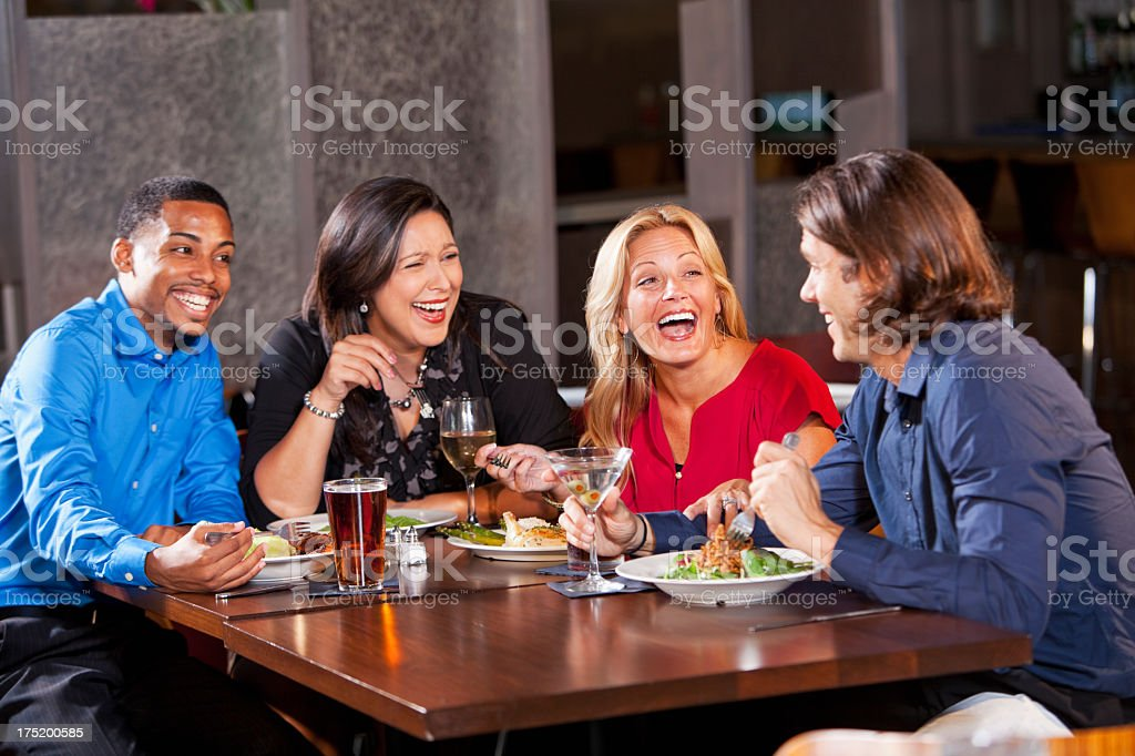 Two couples having dinner at restaurant royalty-free stock photo