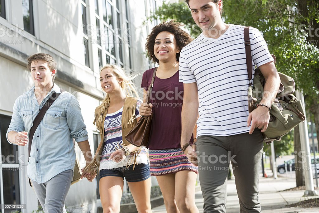 Two couples walking stock photo