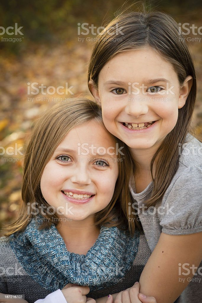 Two Cousins/Friends Hugging in Autumn Woods royalty-free stock photo