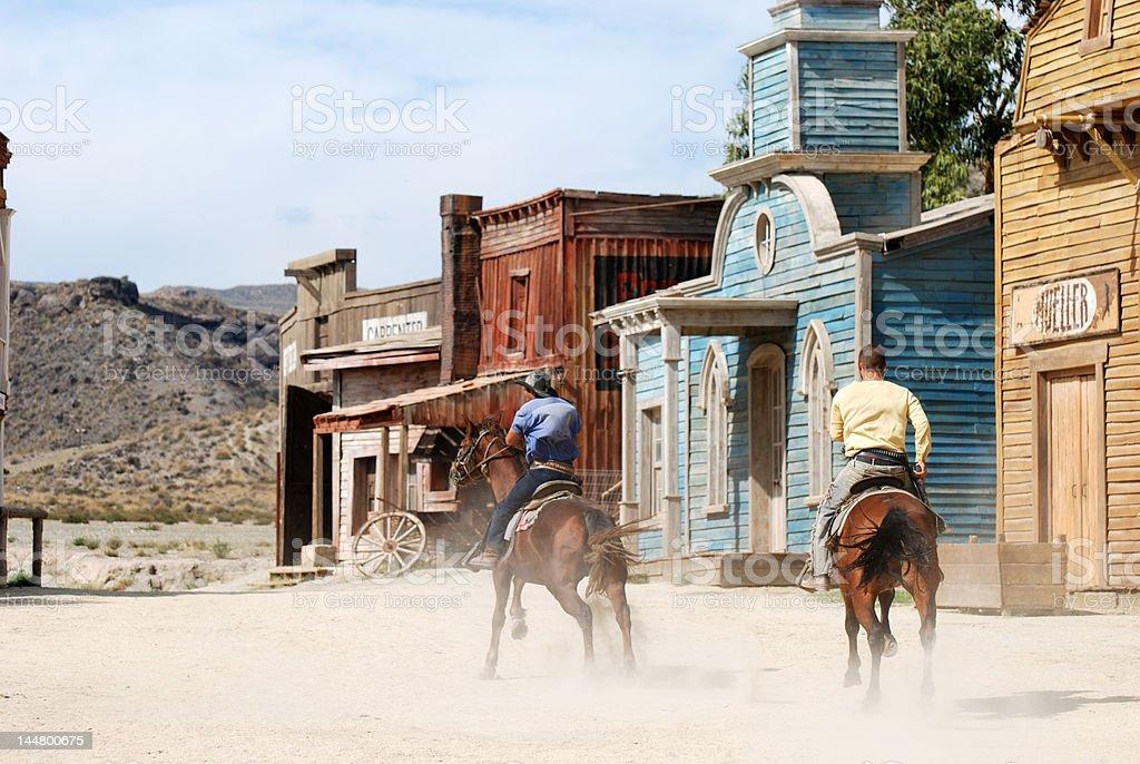 Two Cowboys Riding away royalty-free stock photo