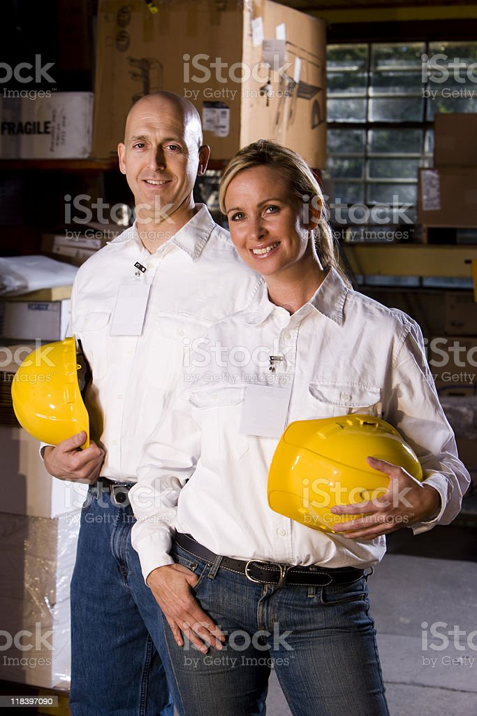 Two co-workers in office storage warehouse royalty-free stock photo