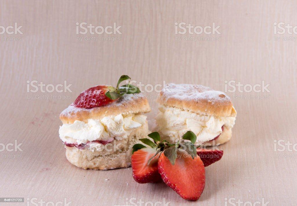Two cream and strawberry jam scones stock photo