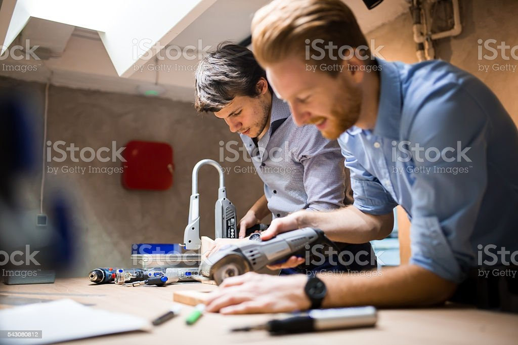 Two creative designers working in workshop stock photo