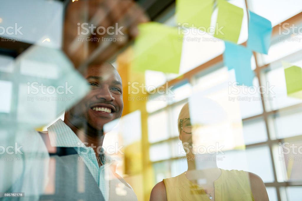 Two creative millenial small business owners working on social media stock photo