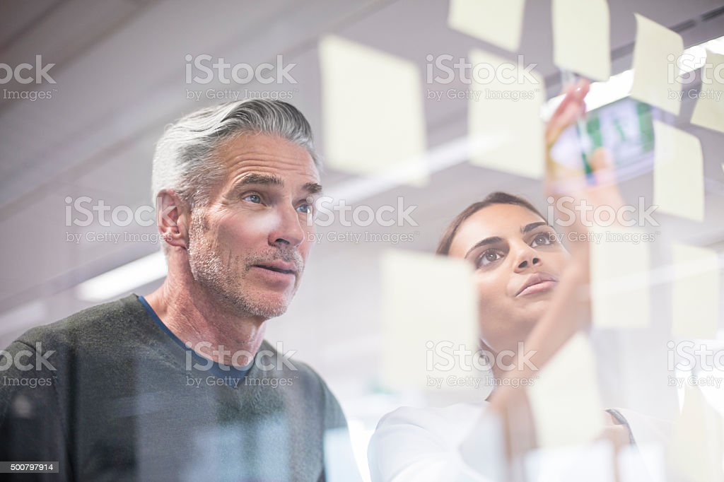 Two creative people working on new ideas stock photo