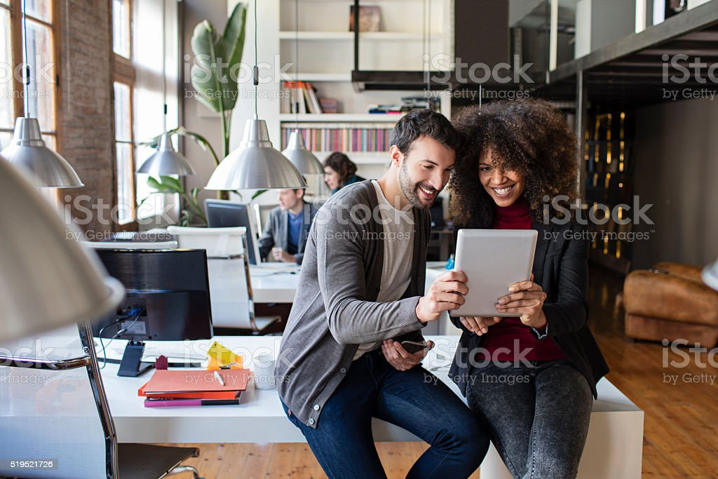 Two creatives people very proud about the new project stock photo
