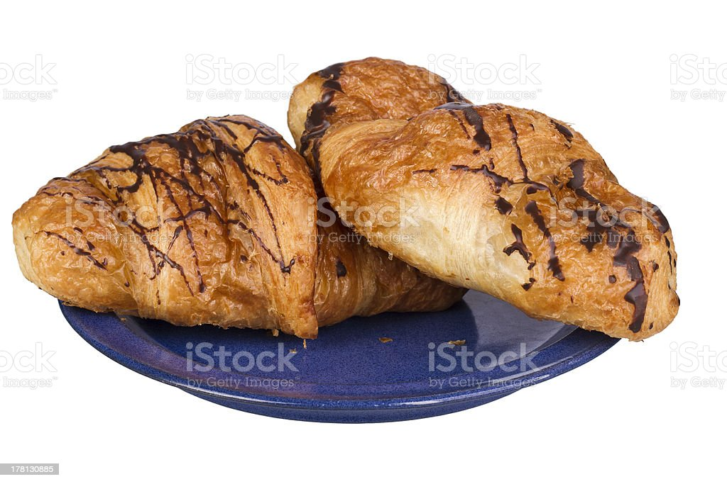 two croissants on blue dish stock photo