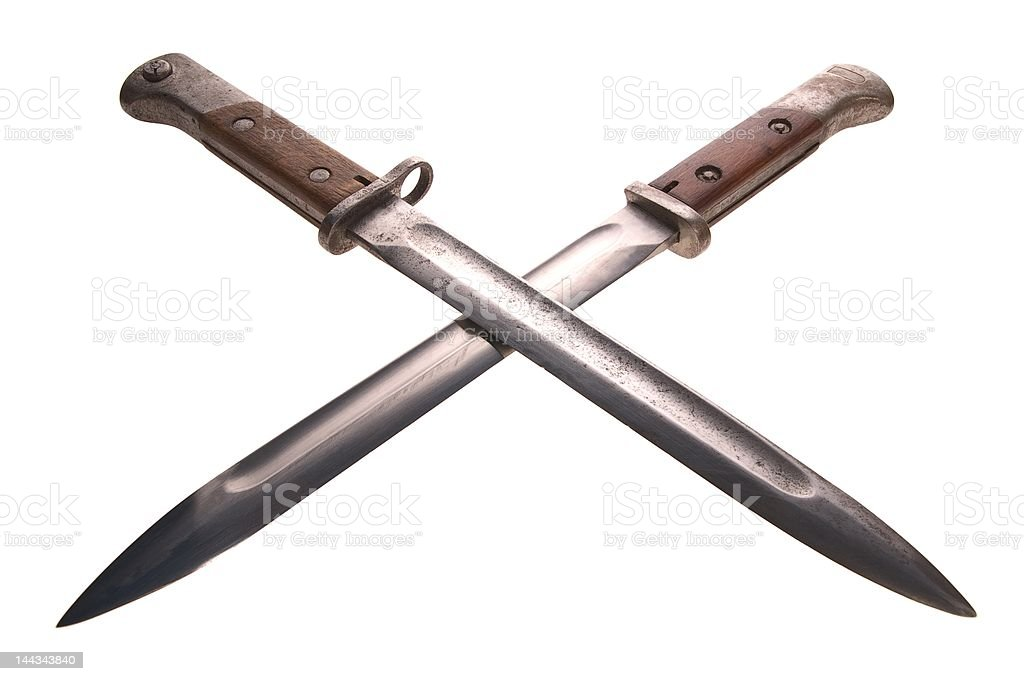 Two crossed bayonets stock photo