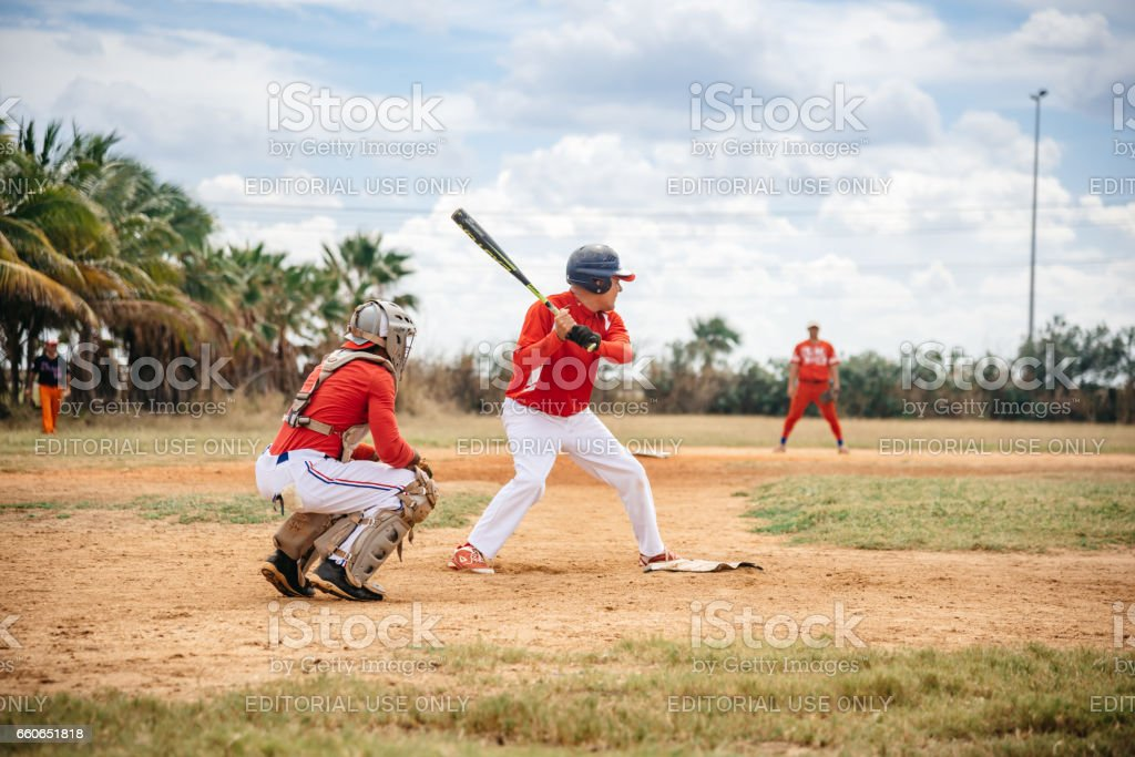 two cuban baseball players on trainings ground in Varadero expecting the ball stock photo