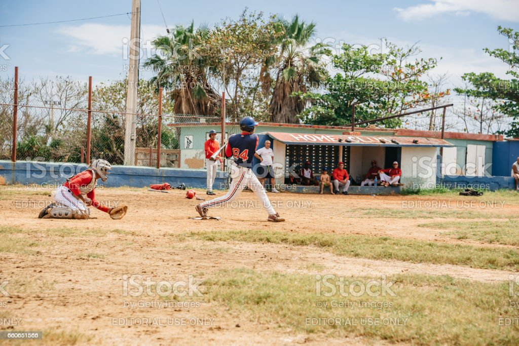 two cuban baseball players on trainings ground in Varadero in action stock photo