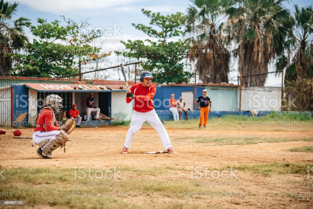 two cuban baseball players on trainings ground in Varadero waiting for ball stock photo