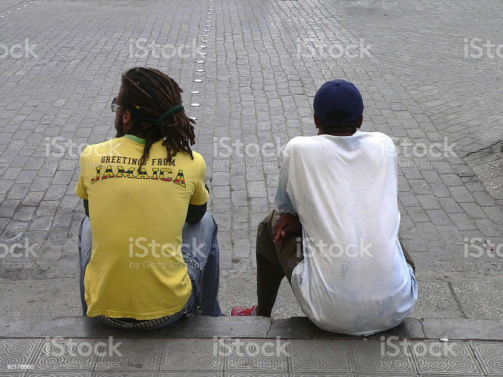 Two Cuban guys relaxing  in Santa Clara royalty-free stock photo