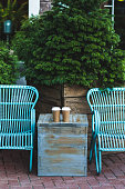 Two cup coffee to go on blue vintage table outdoors