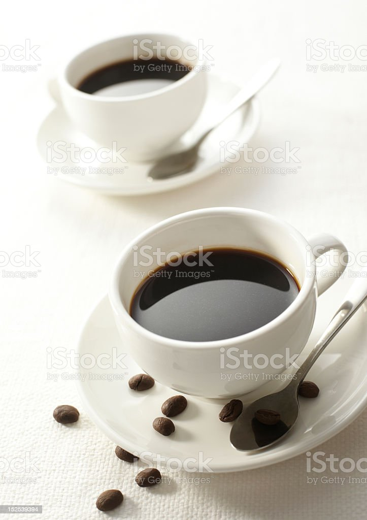 Two cup of coffee on the white background royalty-free stock photo